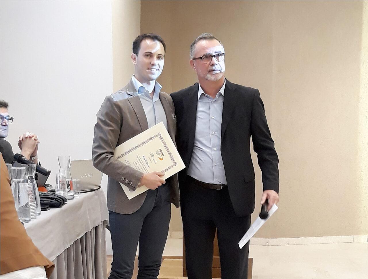 Consigliere Collini con studente premiato